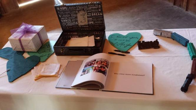 Painted hearts on the gift/guestbook table handmade by the bride.